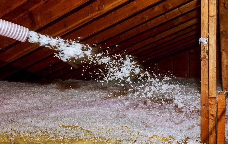 insulation being sprayed