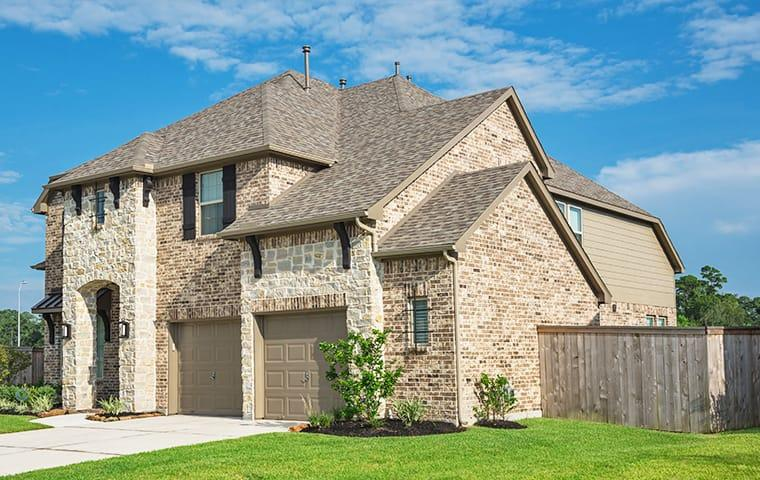 street view of a large brick suburban home in mckinney texas