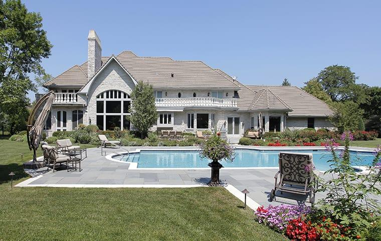 front view of a large home and pool in plano texas