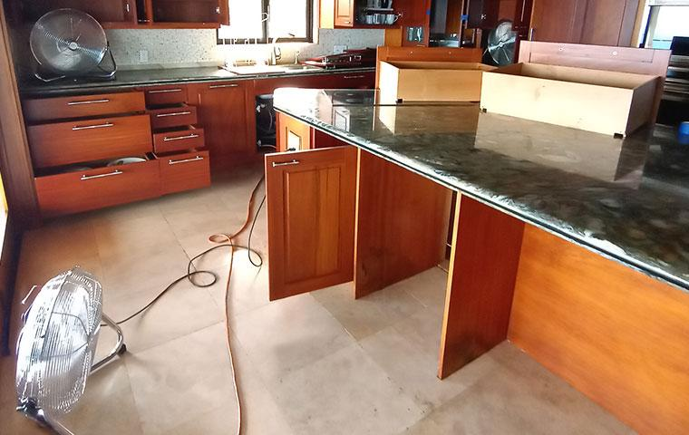 open cabinets and drawers in a kitchen