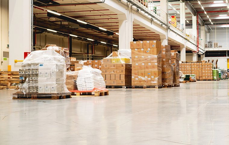 a large warehouse with boxes on tall shelves