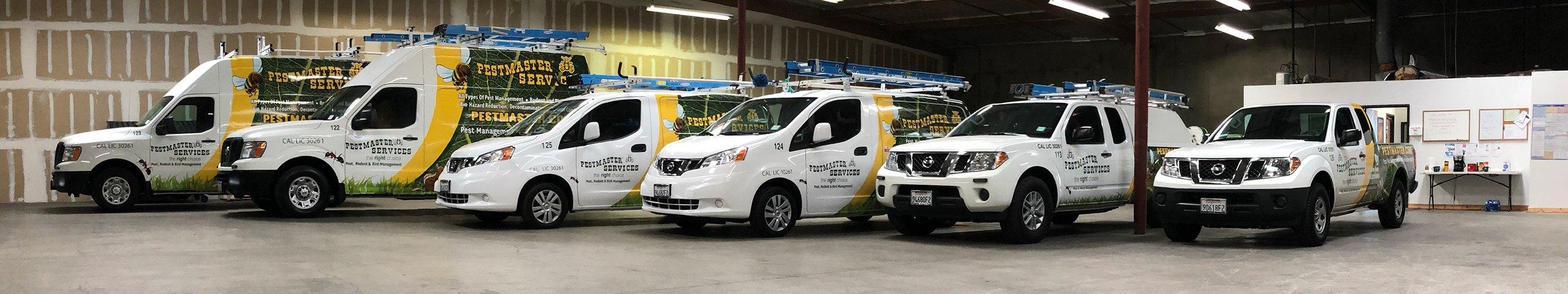 pest control service vehicles parked inside of a commercial building