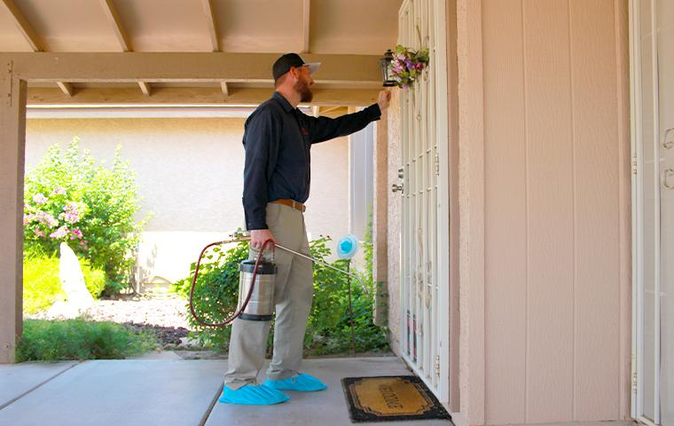technician knocking on a door in mesa arizona