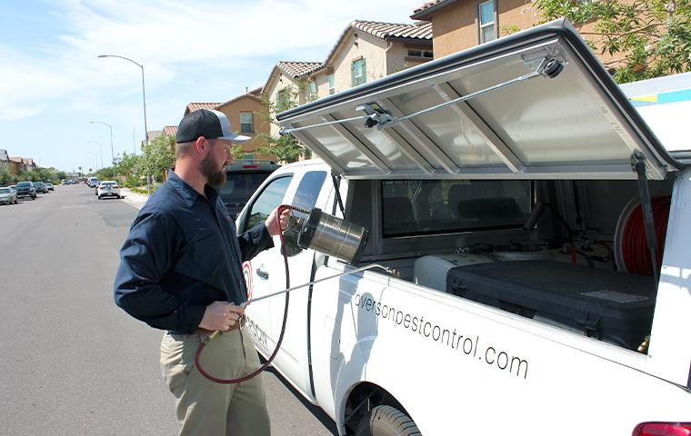 technician getting products from truck in mesa arizona