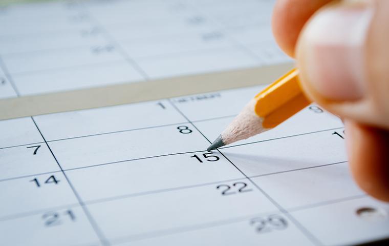person marking the date on a calendar in mesa arizona
