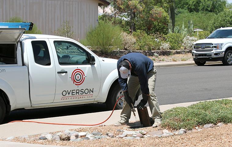 technician inspecting exterior in mesa arizona