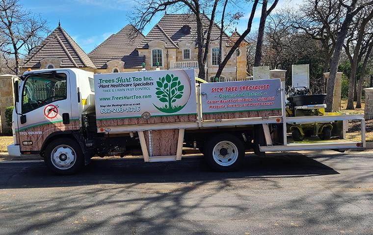pest control truck pulling up to house in tarrant county