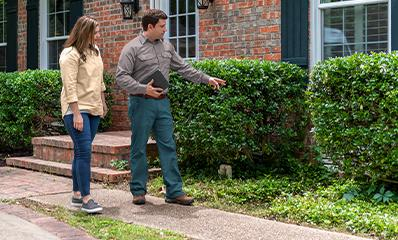 technician and client looking at yard