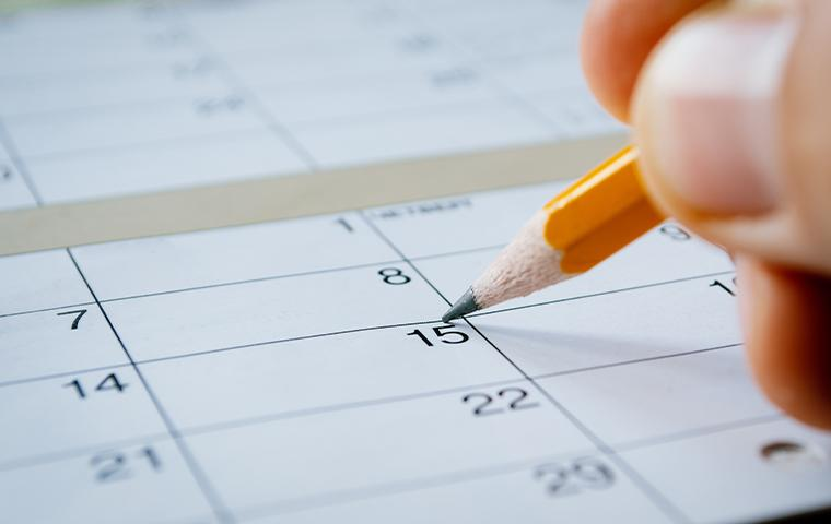 person marking a date on a calendar in tarrant county