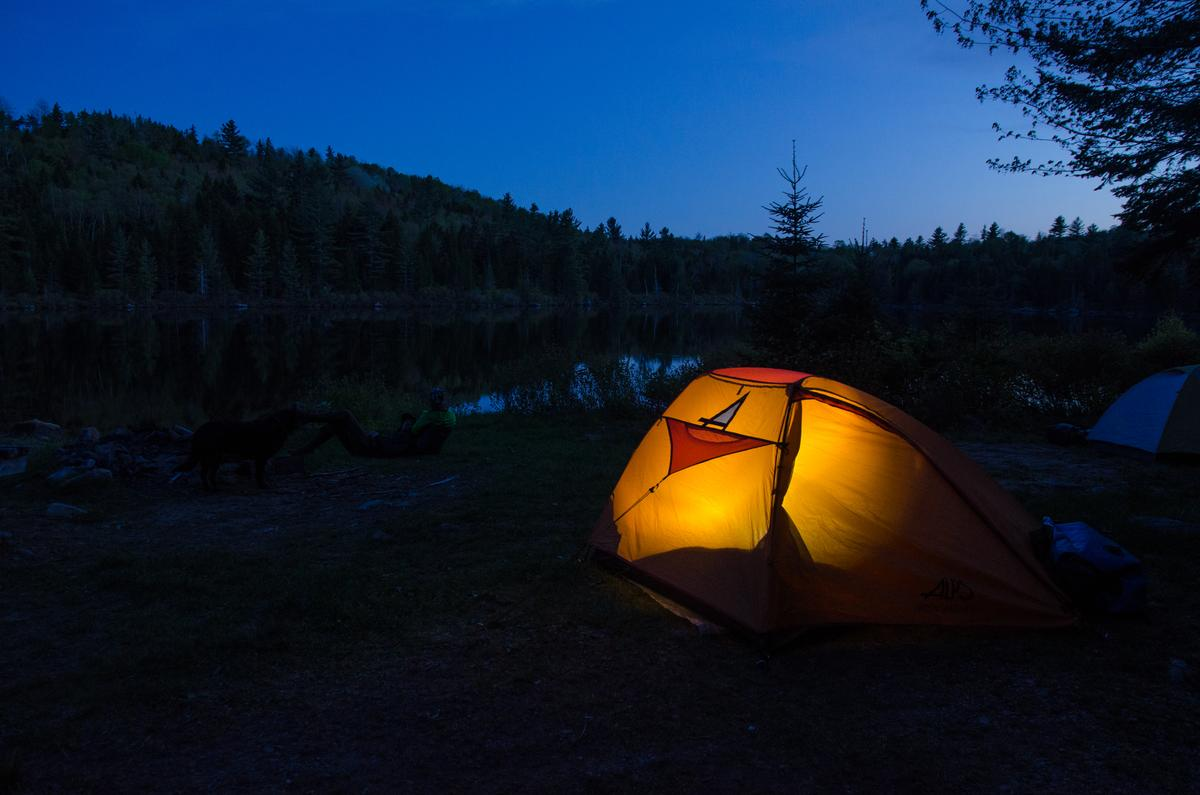 Falling asleep to the cheeps of peepers or the haunting call of loons makes camping in the north Maine Woods an experience to remember. Little Chase Stream Pond, Misery Township.