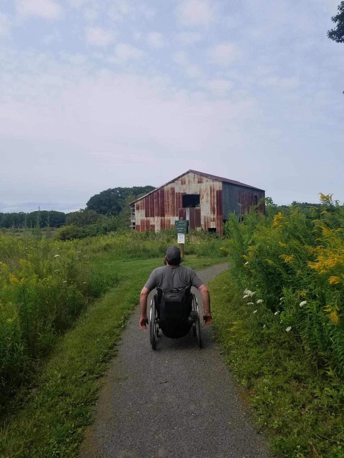 Enock heading toward the old barn at Pleasant Hill Preserve. Photo credit: Enock Glidden