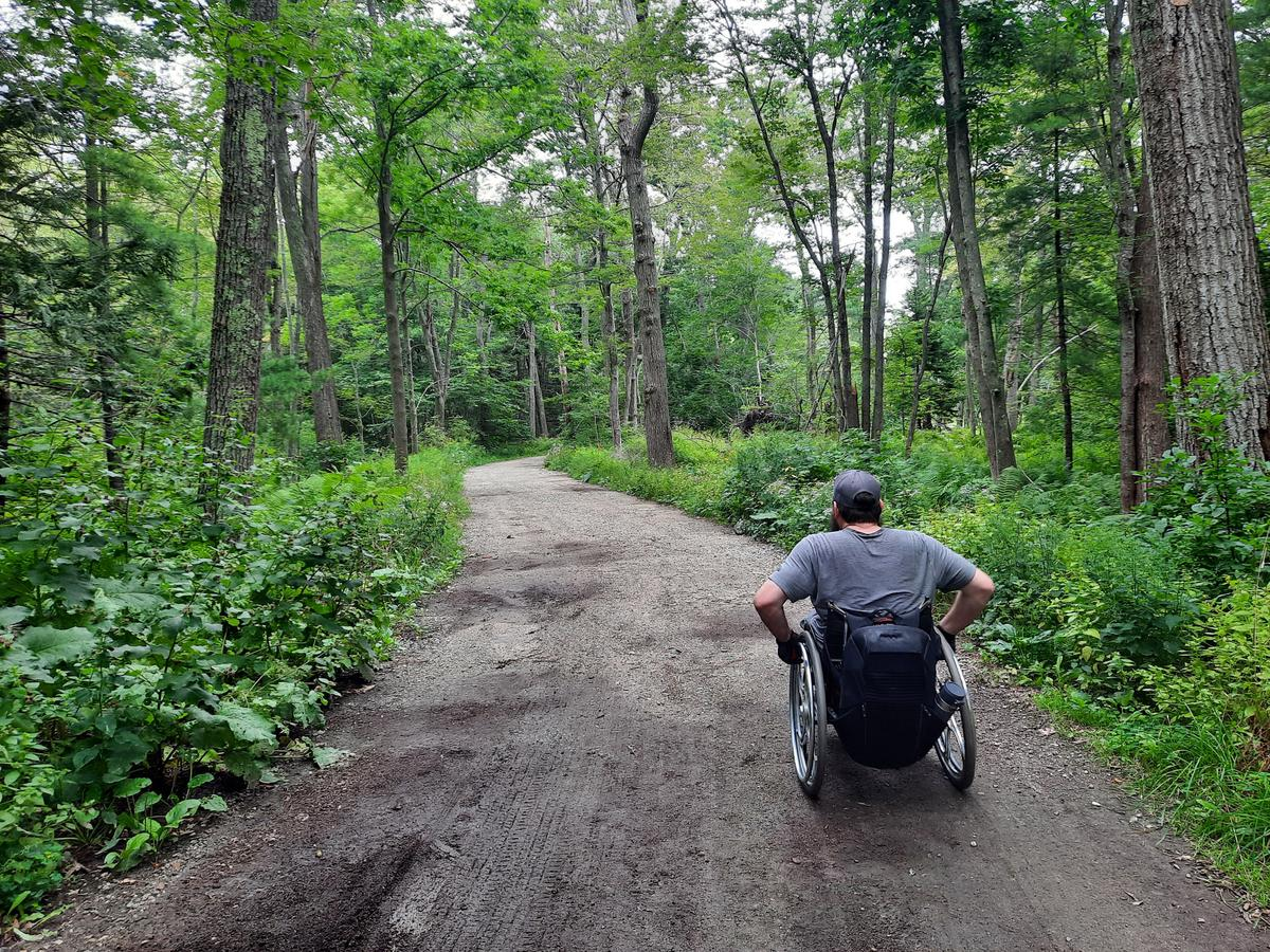 Heading down the road toward the Pond Trail. Photo credit: Enock Glidden