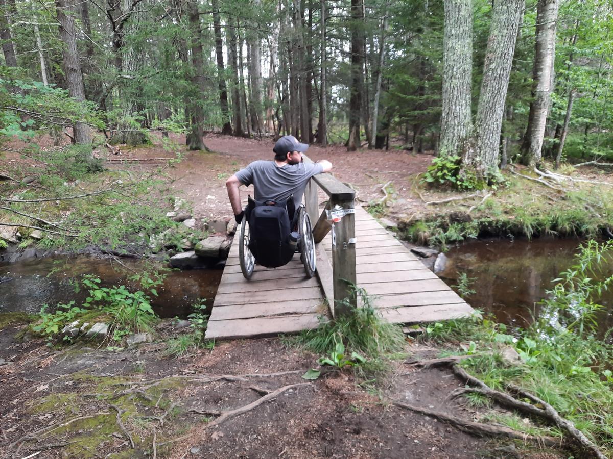 The bridge with a center railing. Photo credit: Enock Glidden