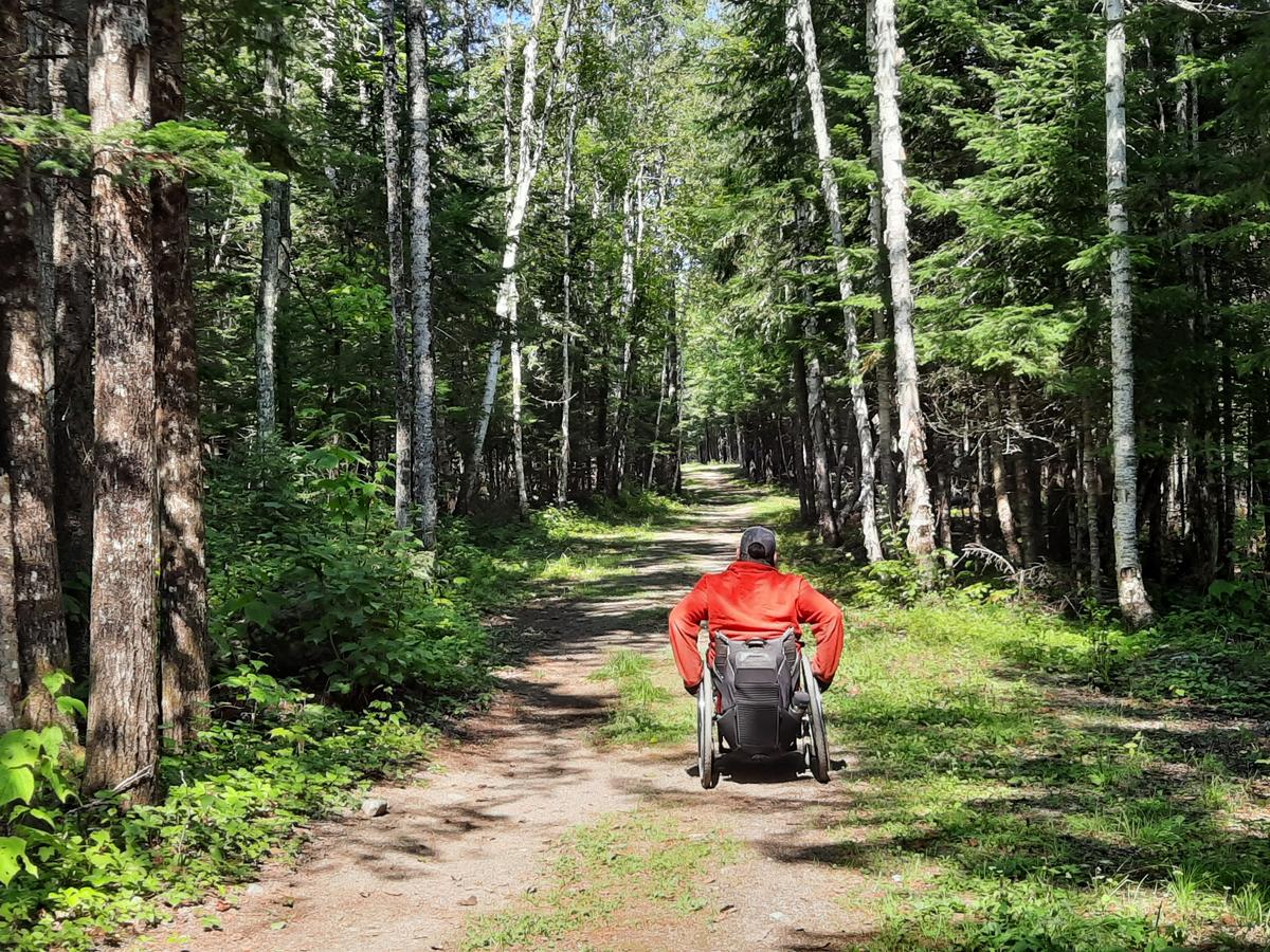 A smooth section of the Rangeley River Trail. Photo credit: Enock Glidden