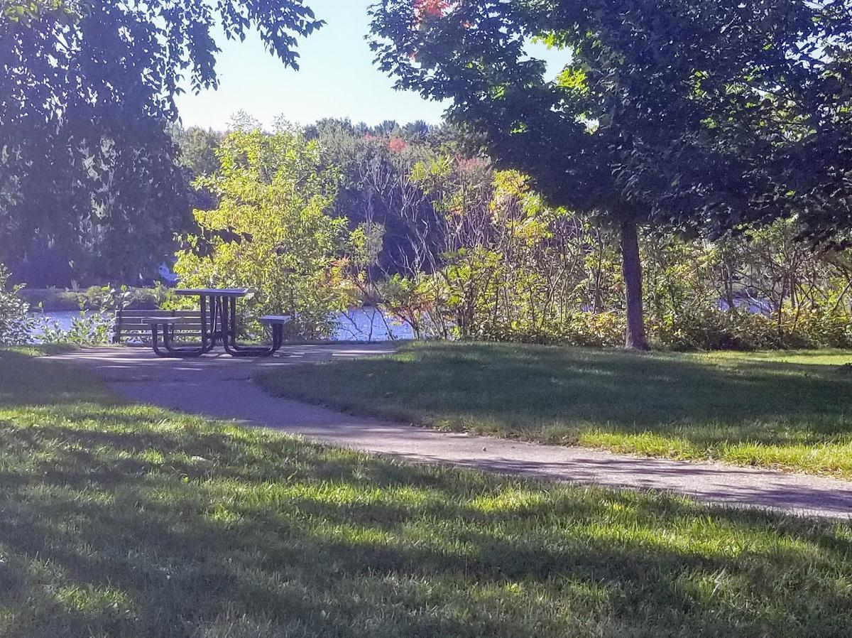 A picnic table along the Kennebec River. Photo credit: Enock Glidden