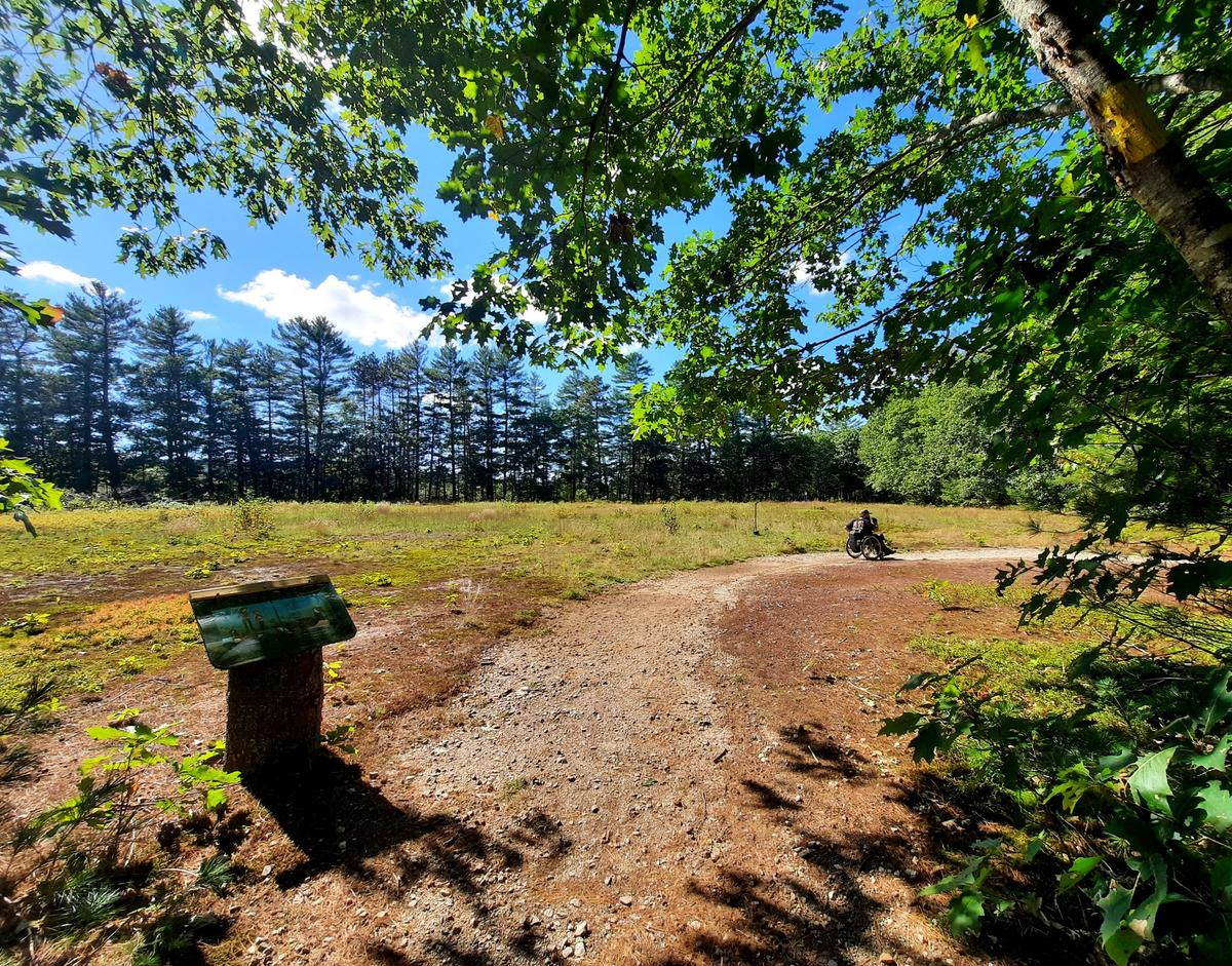 Hiking along the Valentine Farm trail. Photo credit: Enock Glidden