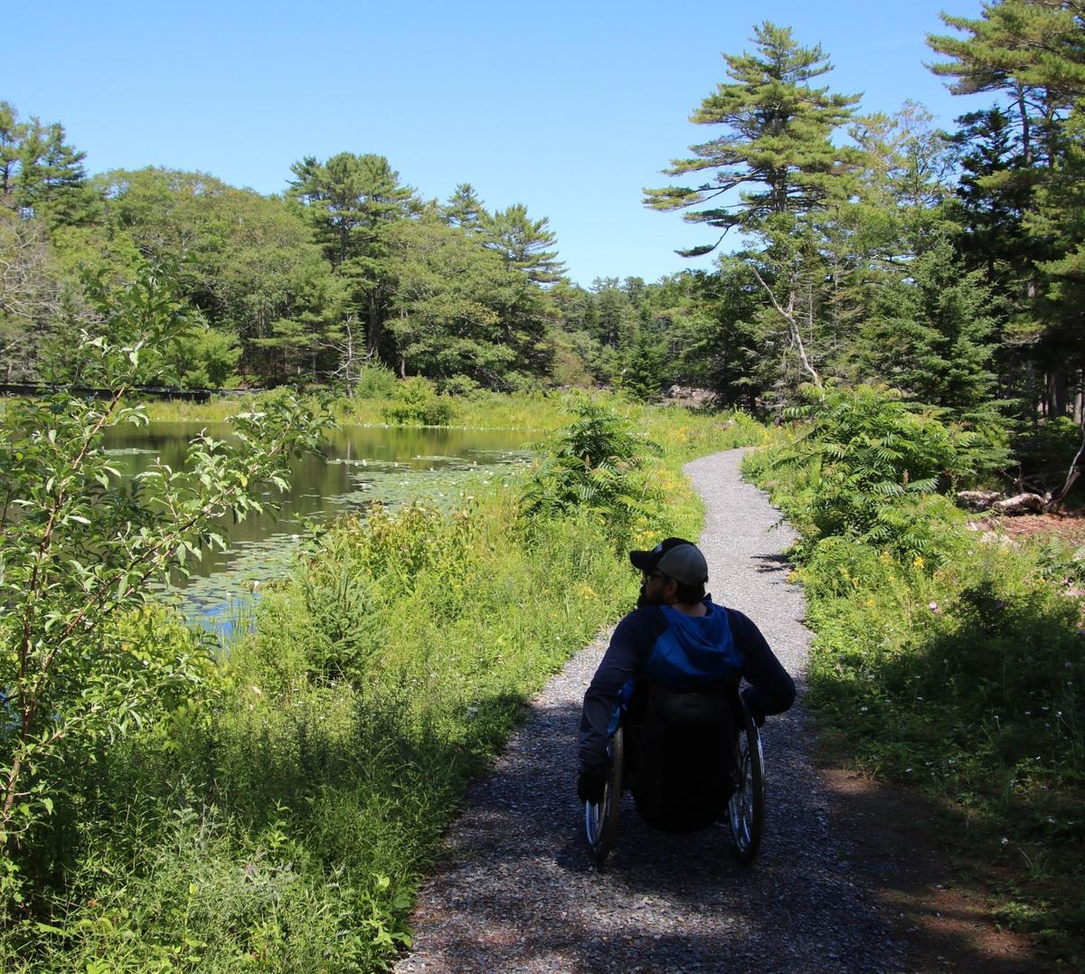 Enock enjoying the trails at Oak Point.