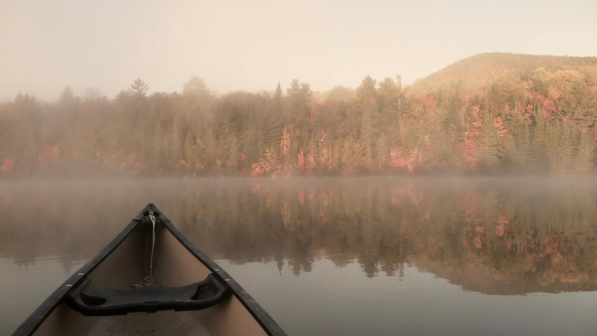 The chill quiet of cool mornings is broken only by the dip of your paddle as summer turns to fall. Pogy Pond, Baxter State Park.