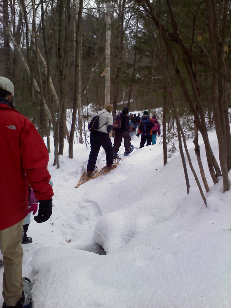 Guided snowshoe hike at a winter family fun event (Credit: Maine Bureau of Parks and Lands)