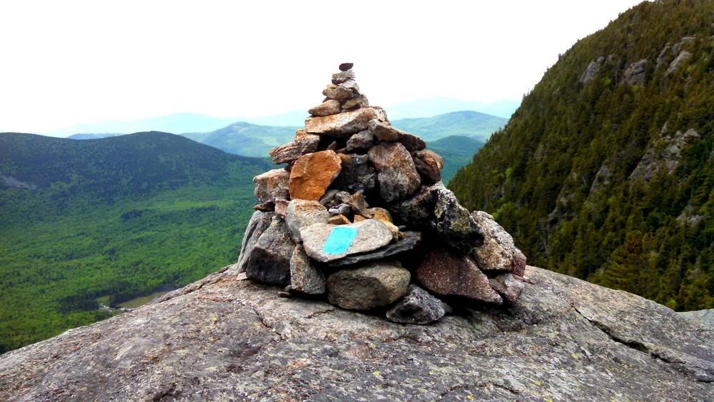 Cairn on top of Tumbledown facing West Peak (Credit: Elizabeth MacMaster)