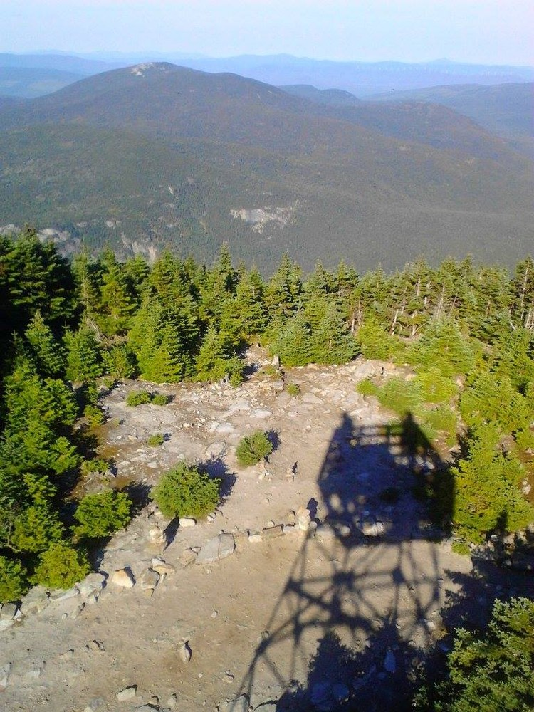 Shadow of the tower on top of Old Speck and the mountains beyond (Credit: Lisa C)