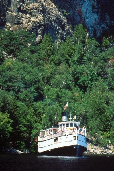 S.S. Katahdin on Moosehead Lake under the cliffs of Mount Kineo (Credit: Maine Bureau of Parks and Lands)