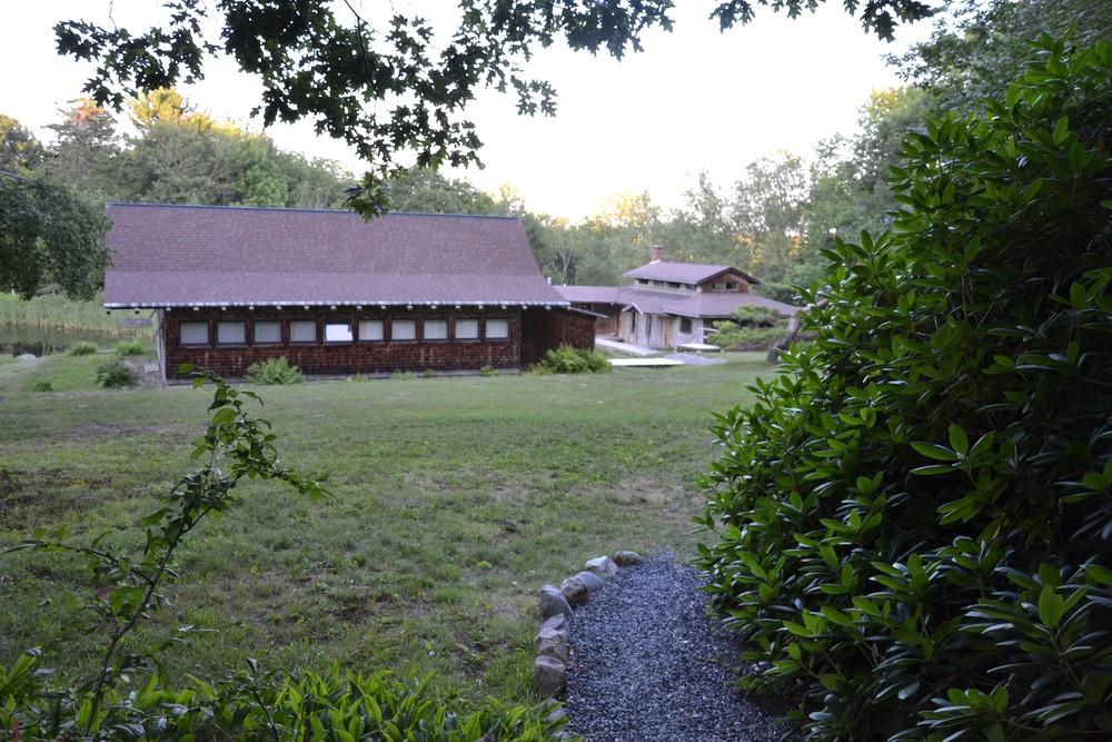 View of Zendo and Meeting Hall in background (Credit: Morgan Bay Zendo)