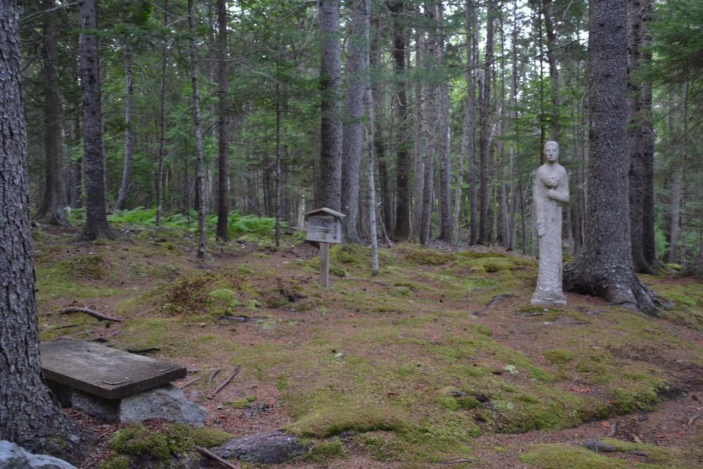 Contemplative bench and Kannon sculpture in Moss Garden (Credit: Morgan Bay Zendo)