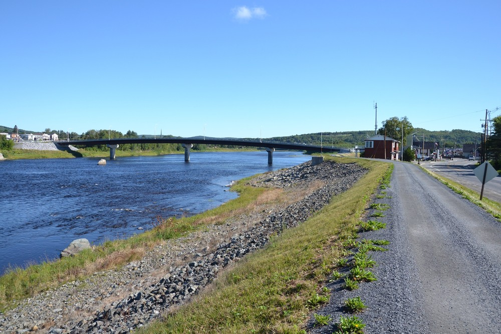 Riverside Trail west of and looking back at the Clair Fort Kent Bridge (Credit: Maine Trail Finder)