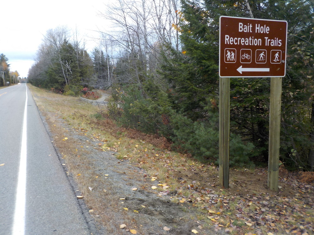 Entrance road sign at Bait Hole Recreation Trails