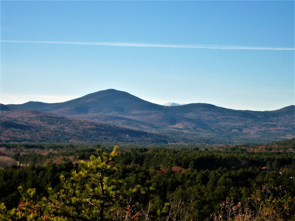 Snowcapped peaks in the White Mountains are just visible to the northwest (Credit: Maine Trail Finder)