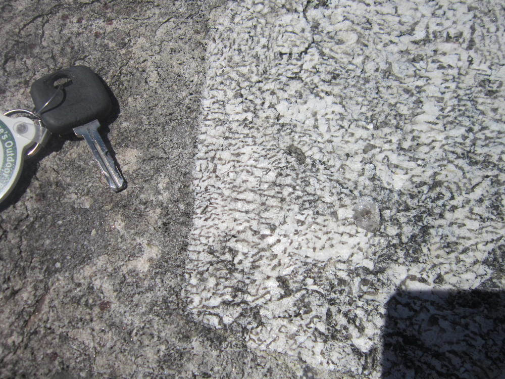 close up of the graphic texture in the feldspar crystals, white is feldspar and the gray is quartz. This texture can be found in many places on the summit. A large portion of Jockey Cap is granitic pegmatite (an exceedingly coarse grained granite).