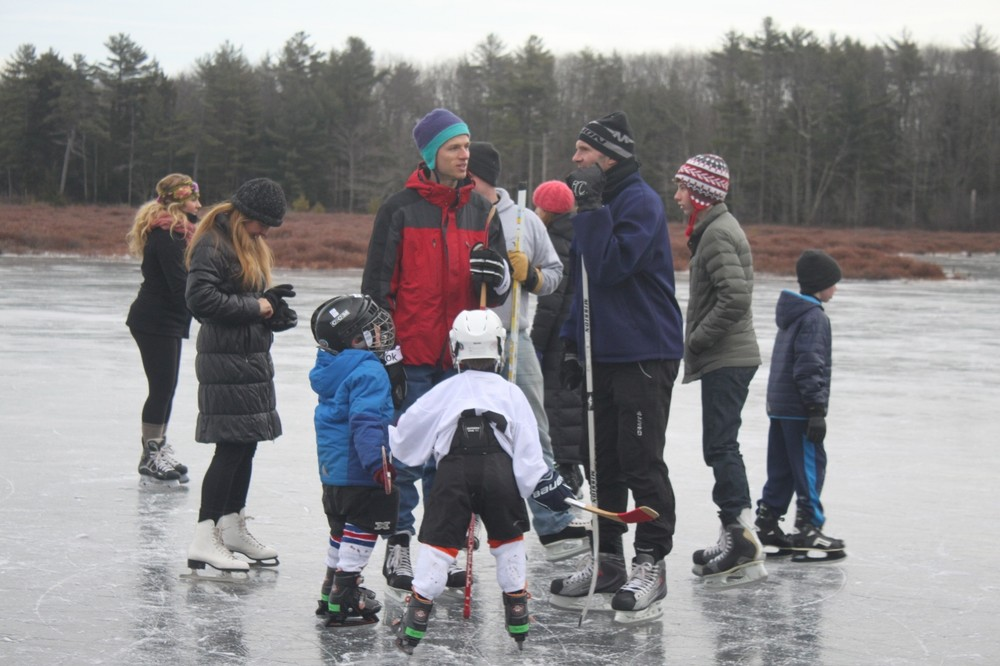 Hockey players on the pond (Credit: Royal River Conservation Trust)