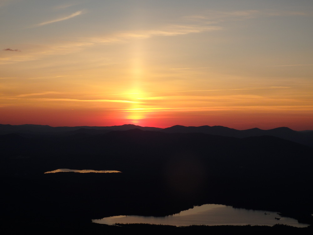 Sunset on July 5th, 2017 over Canada.  Viewed from Saddleback's summit. (Credit: Robert Ratford)