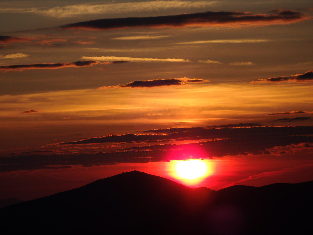 Sunrise on July 6th, 2017 behind Sugarloaf.  Viewed from Saddleback's summit. (Credit: Robert Ratford)