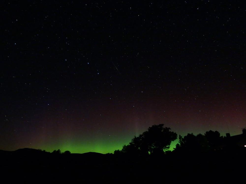 Auroras over the Tumbledown ridge line.  Seen from Webb Lake in Weld. (Credit: Robert Ratford)