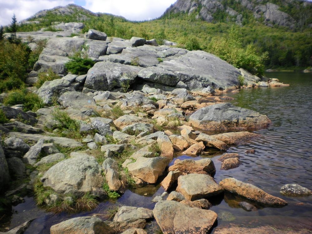 Brook Trail - Rocks by the shore of Tumbledown Pond. (Credit: Chris Nason)