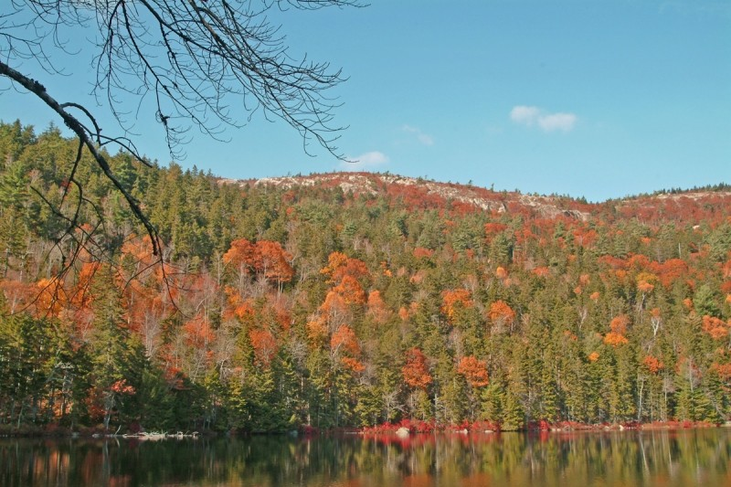 Autumn foliage on Tunk Mountain viewed from Little Long Pond (Credit: Maine Bureau of Parks and Lands)