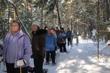Fun on an organized snowshoe hike (Credit: Saco Bay Trails)