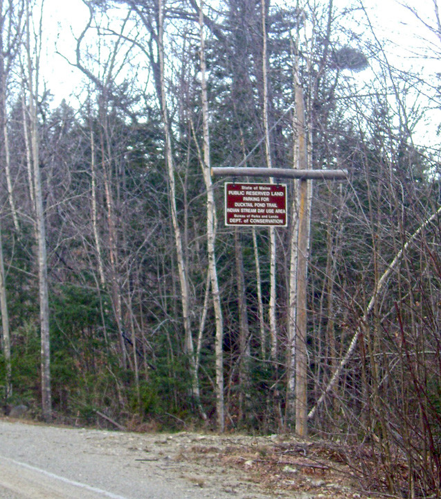 Trailhead yard-arm sign near parking area (Credit: Maine Bureau of Parks and Lands)