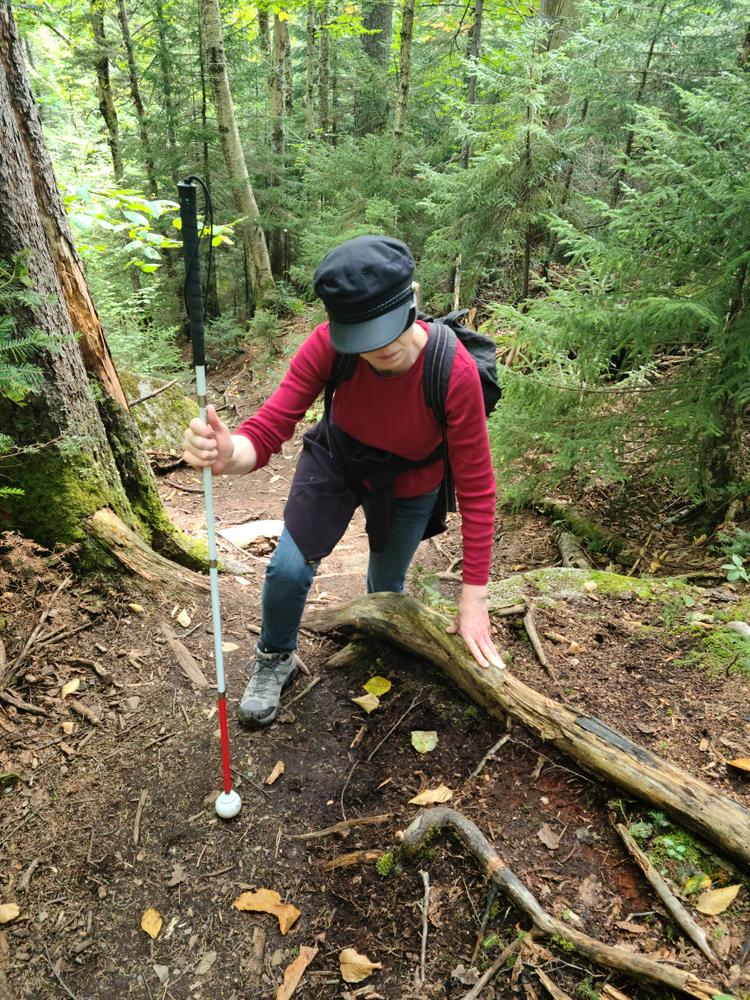 That's not a trekking pole. She is legally blind as of 5 years ago, but doesn't let it stop from enjoying one of her lifelong passions. She's a true inspiration! her from (Credit: Brian Marston)