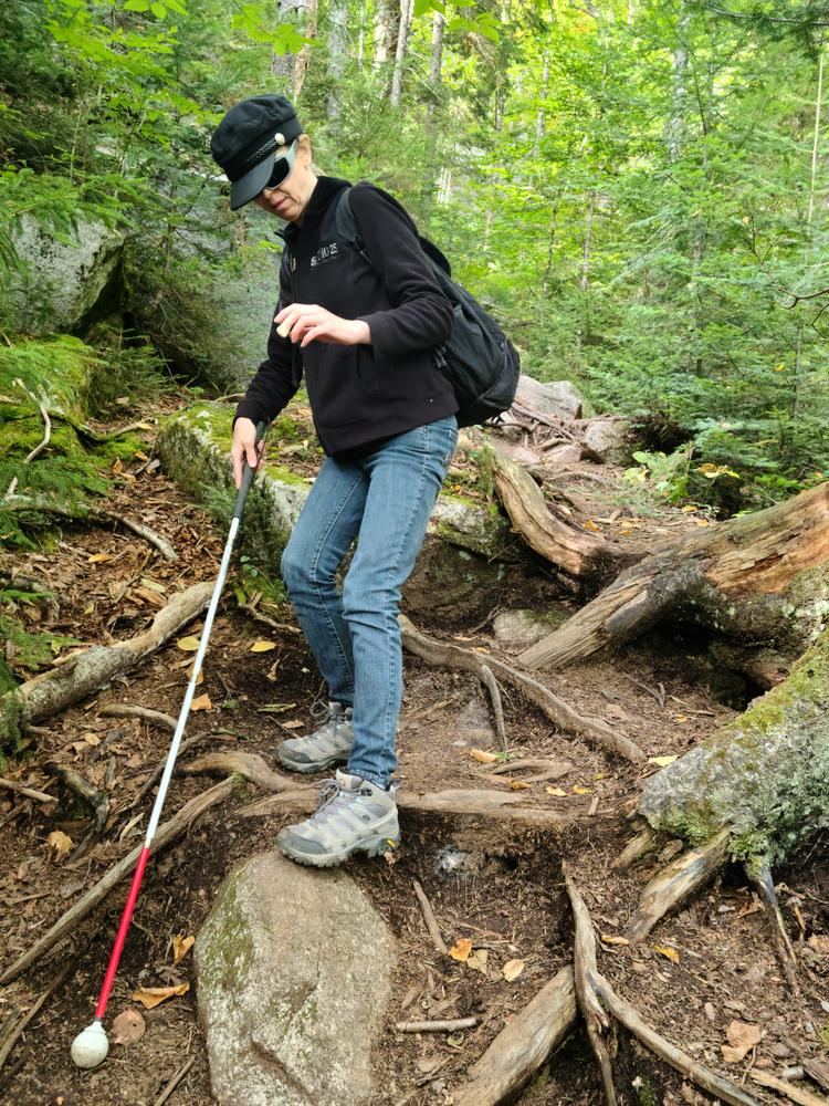 """That's not a trekking pole, it's her """"cane"""" that she uses to feel out the trail. She is legally blind. (Credit: Brian Marston)"""
