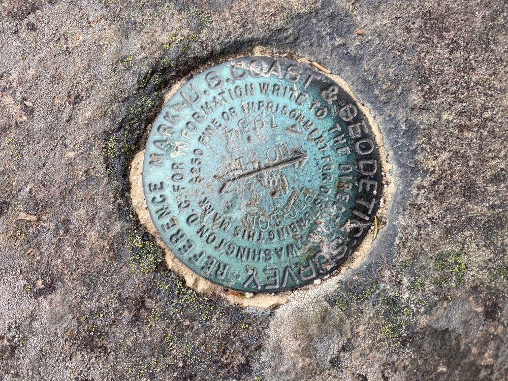 Geodetic survey marker (Credit: K.Hulme)