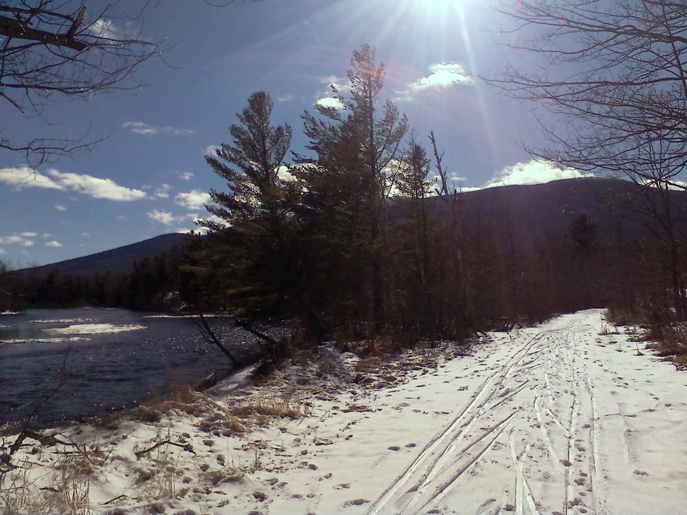 Maine Trail Finder (Credit: Skiing along the East Branch Penobscot on a blue bird day)