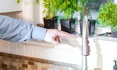 tech inspecting a kitchen sink
