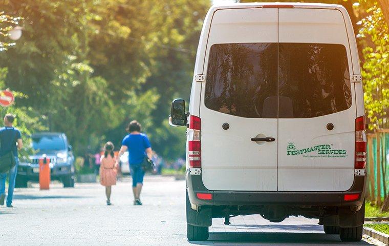 a company vehicle outside of house