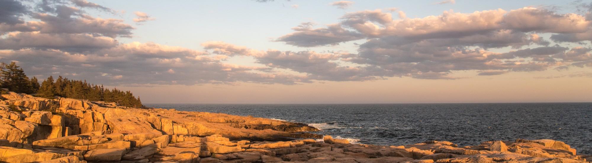 Sunrise on rocks at ocean's edge