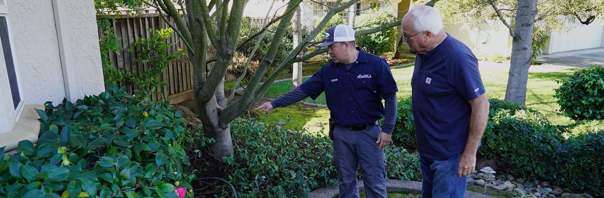 smith's pest management technician with client