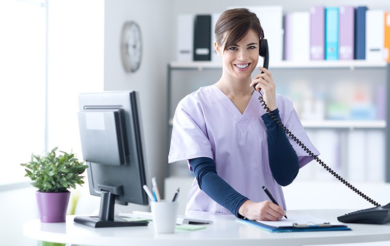a hospital receptionist on the phone