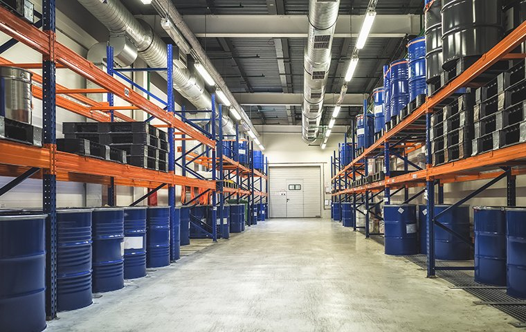 a large warehouse with barrels on tall shelves